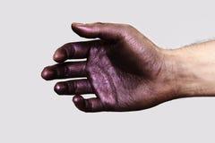 Ontspannen Hand met purpere Verf op Huid stock afbeeldingen