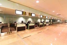 Ontvangst (controle in registratie) bij de internationale luchthaven Royalty-vrije Stock Afbeeldingen