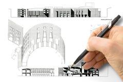 Ontwerp een nieuwe stad - Handtekening met een potlood een schets van een nieuwe moderne stad binnenland - conceptenbeeld - ik be stock fotografie