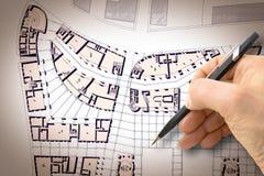 Ontwerp een nieuwe stad - Handtekening met een potlood een schets van een nieuwe moderne stad binnenland - conceptenbeeld - ik be royalty-vrije stock afbeelding