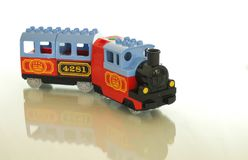 Ontwerper en trein - een grote combinatie voor een stuk speelgoed stock foto's