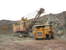 Ontwikkeling van steenkool in de steengroeve stock foto