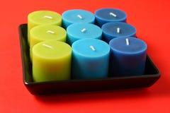 Onverbrande kaarsen in een zwarte houder stock foto