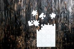 Onvolledig wit raadsel met het missen van stukken Stock Afbeeldingen