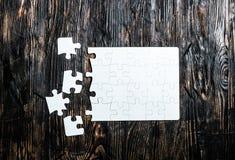 Onvolledig wit raadsel met het missen van stukken Stock Fotografie