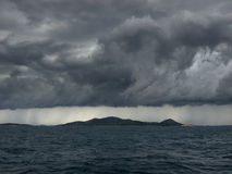 Onweer over eilanden Stock Afbeeldingen