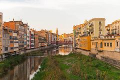 Panorama of Gerona, Costa Brava, Catalonia, Spain. Onyar river crossing the downtown of Girona with bell tower of Basilica of Sant Feliu in background. Gerona Stock Photo