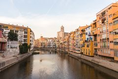 Panorama of Gerona, Costa Brava, Catalonia, Spain. Onyar river crossing the downtown of Girona with bell tower of Basilica of Sant Feliu in background. Gerona Royalty Free Stock Photography
