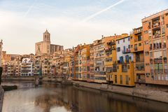 Panorama of Gerona, Costa Brava, Catalonia, Spain. Onyar river crossing the downtown of Girona with bell tower of Basilica of Sant Feliu in background. Gerona Stock Photography