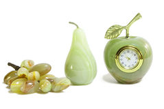 Onyx fruits. Green onyx fruits – grapes, pear and apple-clock Royalty Free Stock Photography