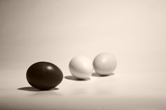 Onyx, gypsum, marble. Three colored chicken eggs lie on the plane stock image