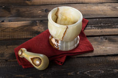 Onyx Mortar and Pestle on wooden Background Royalty Free Stock Photos