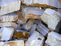 Onyx stone material. The raw pieces of natural stone onyx on a bright sunny day Royalty Free Stock Photos