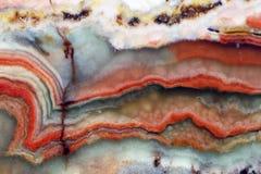 Onyxnaturstein - Schichten verschiedene Farben stockbild