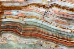 Onyxnaturstein - Schichten verschiedene Farben stockfotos