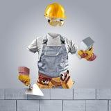 Onzichtbare arbeider met troffel en bakstenen muur Royalty-vrije Stock Afbeelding