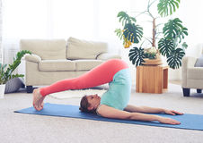 Ood-looking lady in plow asana on yoga mat Royalty Free Stock Photography