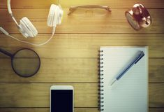 Ood office desk table with a lot of things Royalty Free Stock Photos