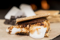 Ooey Gooey Marshmallow Smore. On brown paper Royalty Free Stock Photo