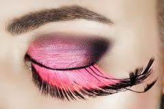 Oog met roze wimpers Stock Foto
