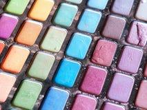 Oogschaduw en lipgloss Stock Foto