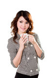 Ooh a great cup of hot beverage. Young business woman enjoying her great cup of beverage Royalty Free Stock Photos