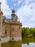 Tower and moat in Ooidonk castle Stock Photo