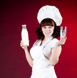 Ook woman with fresh half milk bottle Stock Photos
