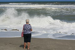Senior women looking at sea waves Stock Image