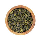 Oolong green tea heap in bowl Stock Images
