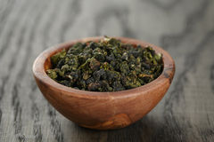 Oolong green tea in olive bowl Stock Photography