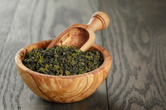 Oolong green tea in olive bowl Stock Images