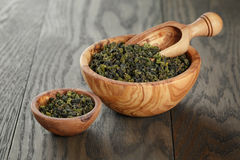 Oolong green tea in olive bowl Stock Image