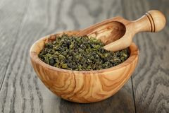 Oolong green tea in wood bowl Royalty Free Stock Photography