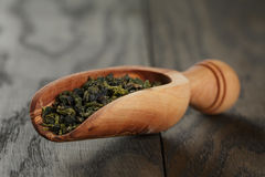 Oolong green tea in wood scoop Stock Photo