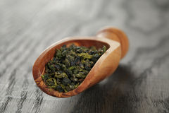 Oolong green tea in wood scoop Stock Image