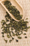 Oolong Tea. Chinese green tea with bamboo spoon on a mat Royalty Free Stock Photos
