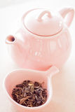 Oolong tea in ceramic cup and jar Royalty Free Stock Photo