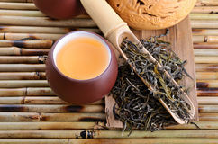 Oolong tea. Cup of  aromatic oolong tea on bamboo mat background Royalty Free Stock Photo