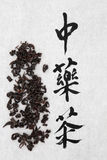 Oolong Tea. Oolong herb with chinese calligraphy script over rice paper background. Translation reads as chinese herbal tea Royalty Free Stock Photo
