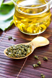 Oolong Tea leaf. In wooden spoon Stock Photos