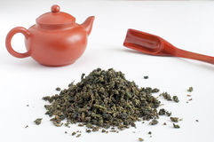 Oolong tea  leaves with a pot Royalty Free Stock Image