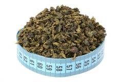 Oolong tea och mäter Royaltyfri Foto