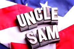 Oom Sam op Amerikaanse Vlag stock foto's