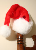 Ooohhhh Santa!. Santa leaves his hat on the bed post, hmmmmm Royalty Free Stock Photo