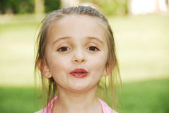 Ooooooo. Cute little girl singing with her mouth shaped as if she's saying Oooooo Royalty Free Stock Images