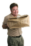 Oooops!. A guilty looking delivery man holding a smashed package stock photo