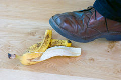 Ooops, bananeschil. Stock Afbeelding