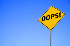 Oops. Image of a oops road sign with a blue sky Stock Photos
