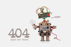 Oops 404 error page not found. Futuristic robot concept with electrical wire hairstyle. Circuits socket chip toy. Mechanism, funny head, colored eyes, light Royalty Free Stock Photos